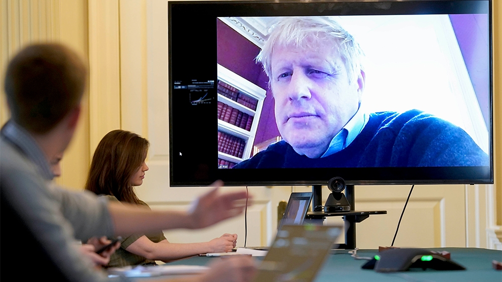 In this handout photo provided by Number 10 Downing Street, Britain's Prime Minister Boris Johnson chairs the morning Covid-19 Meeting remotely after self isolating after testing positive for the coro