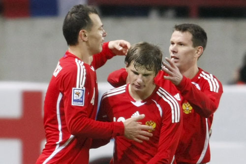 Andrei Arshavin looks ecstatic after his late goal against Finland [EPA]