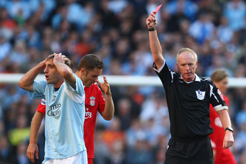 Peter Walton gives his best schoolmaster look as he sends off Manchester City's Pablo Zabaleta [GALLO/GETTY]