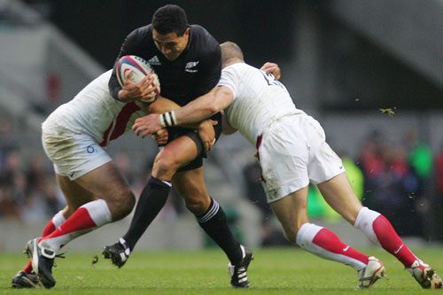 All Blacks' Isaia Toeva fights his way through England`s defence [AFP]