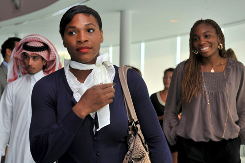 Serena and Venus Williams arrive for the WTA Championships in the Qatari capital [EPA]