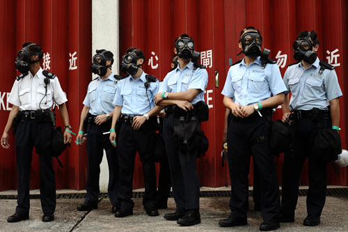 "Policemen stand ready during an ""anti-terror"" drill at the Shatin Olympic Equestrian Venue in Hong Kong [AFP]"