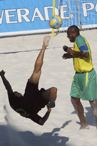 Brazil challenges Portugal during their FIFA Beach Soccer World Cup 2008 match in Marseille, France [Reuters]