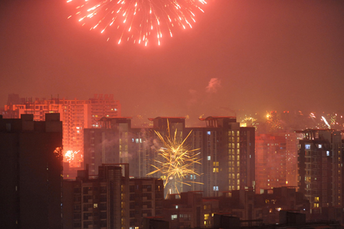 Fireworks illuminate the skyline as residents of Beijing welcome the Year of the Ox [AFP]