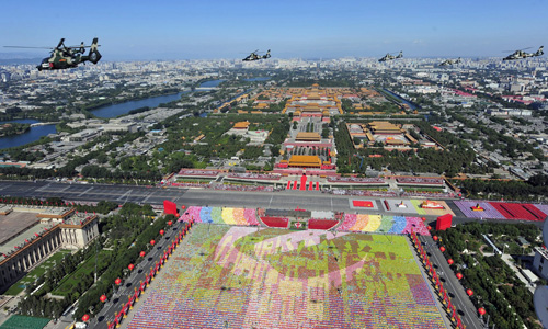 China has marked the 60th anniversary of communist rule with a massive parade through the heart of Beijing [Reuters]
