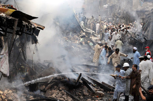 A car bomb ripped through a crowded market in the Pakistani city of Peshawar on Tuesday [AFP]