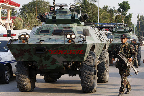 Thousands of troops in tanks and warplanes have taken control of the southern province of Maguindanao, after Gloria Macapagal Arroyo, the Philippine president, declared martial law in the area [EPA]