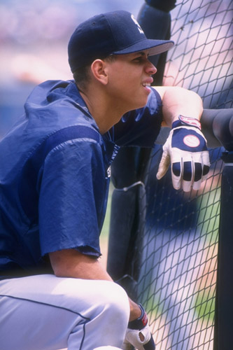 Seattle Mariners' 21-year-old infielder Alex Rodriguez looks on against Chicago White Sox in 1996 [GALLO/GETTY]