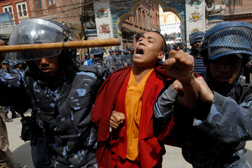 Tibetan exiles have been rallying around the world to mark 50 years since a failed uprising against Chinese rule [AFP]