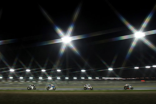 Early showers can't stop a shortened 250cc race going ahead under the desert lights [AFP]