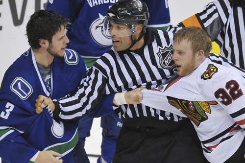 Let's spare a thought for the referee after a week where the profession has come under fire - here a ref keeps the peace between the Vancouver Canucks and the Chicago Blackhawks [GALLO/GETTY]