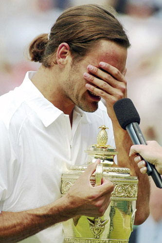 A 21-year-old Roger Federer sheds the first of many victory tears as he wins Wimbledon in 2003 [GALLO/GETTY]