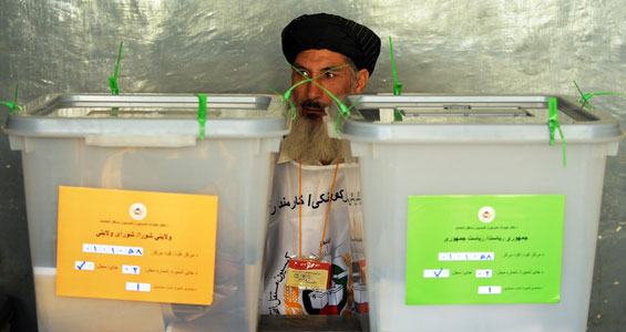Afghans voted to choose a new president and provincial councillors. Presidential ballots went into the green box, provincial ballots into the brown box [AFP]