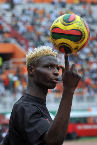 Bance Aristide of Burkina Faso shows off some skills ahead of kickoff in Abidjan [AFP]