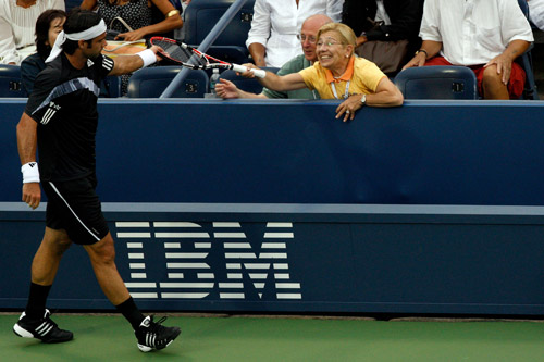 Fernando Gonzalez of Chile donates his racket to a delighted fan after beating Jo-Wilfried Tsonga of France [AFP]