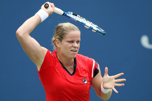 Kim Clijsters of Belgium returns a shot against Na Li of China during day nine of the 2009 U.S. Open at the USTA Billie Jean King National Tennis Center on September 8, 2009 in the Flushing neighborhood of the Queens borough of New York City. Nick Laham/Getty Images/AFP
