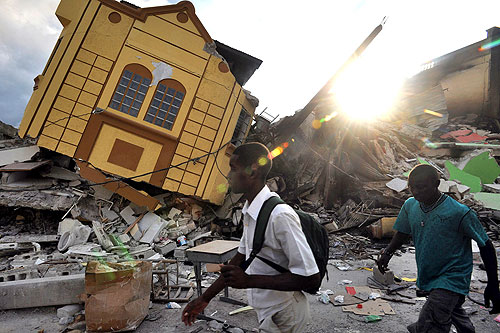 Haiti government officials say more than 100,000 people may have been killed in the massive earthquake that struck the capital, Port-au-Prince, on Tuesday [AFP]