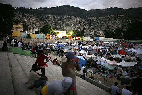 Thousands of earthquake survivors in Haiti are clamouring for basic necessities in the aftermath of the disaster on Tuesday [Reuters]