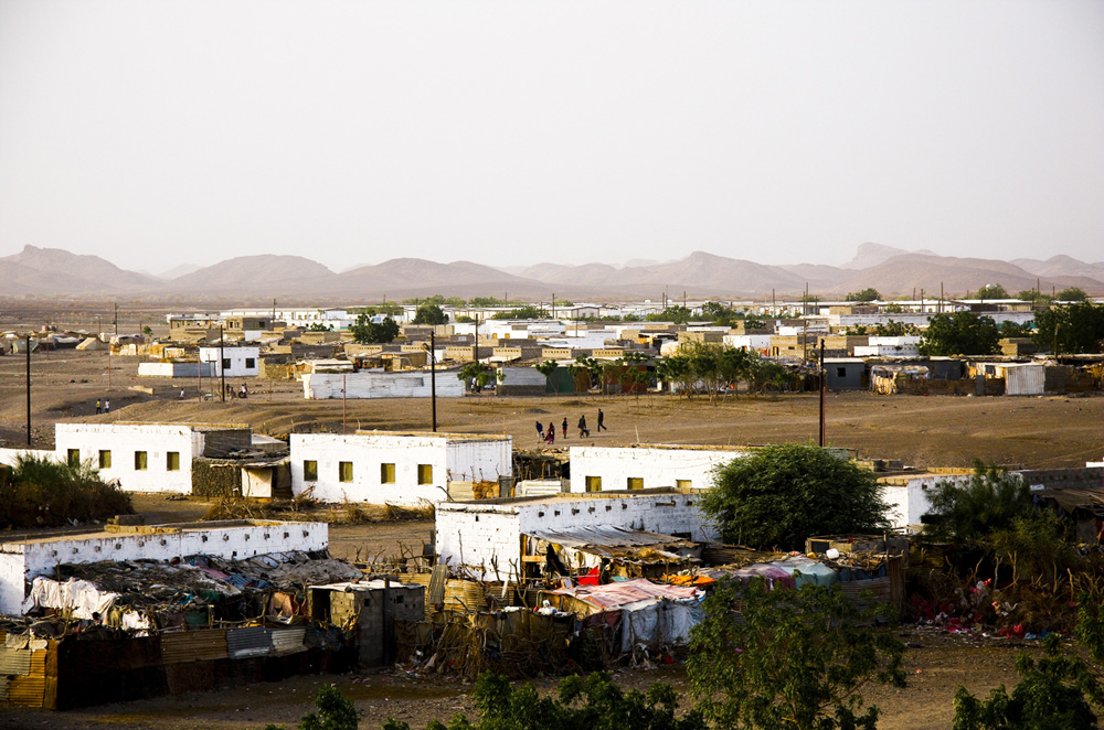 A view of Kharaz refugee camp set on the site of an old military base in south Yemen. Here 17,000 mainly Somali refugees endure the scalding hot sun and dry and dusty winds [Annasofie Flamand]