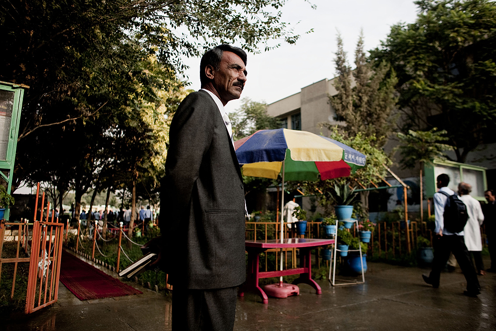 Assadullah Kohistani, the principal of Ghulam Haider Khan High School in Kabul, watches over the courtyard as students arrive for morning assembly [Eros Hoagland]