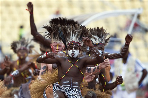 Traditional dancers kick of the Africa Cup of Nations final between Egypt and Ghana at the November 11 stadium in Luanda, Angola [AFP]