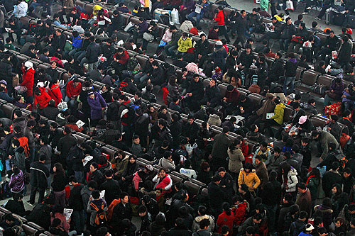 Millions of Chinese have begun the annual mass exodus ahead of family reunions to usher in the Year of the Tiger [EPA]