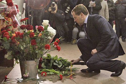 Dmitry Medvedev, the Russian president, has vowed to hunt down those behind two bombings in Moscow on Monday that killed at least 38 people [AFP]