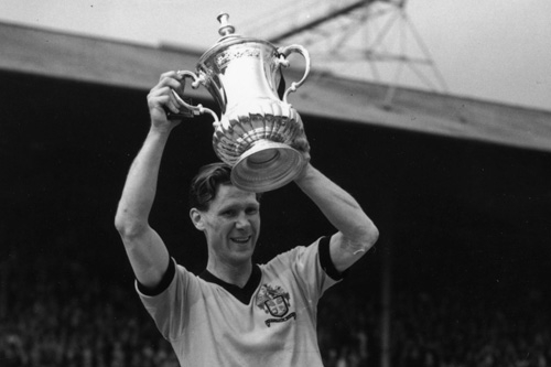 Bill Slater lifts the FA Cup for Wolves in 1960 - years before the competition started playing third fiddle to league and European success [GALLO/GETTY]
