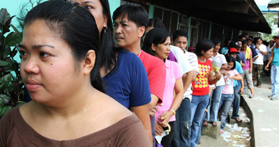 Filipinos have had to endure long lines to choose their new president, with many waiting hours outside polling stations [All pictures by Omar Khalifa/Al Jazeera]