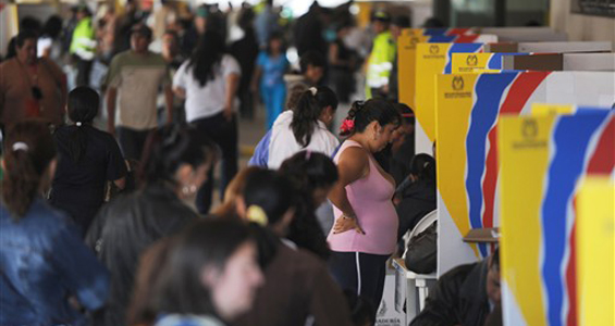 About 50 per cent of Colombians, an unprecedented number, were estimated to have cast their ballot in the presidential election on Sunday [AFP]