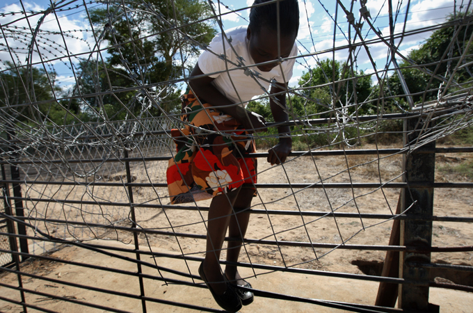 What motivates thousands of children to take great risks smuggling themselves across the border into South Africa?