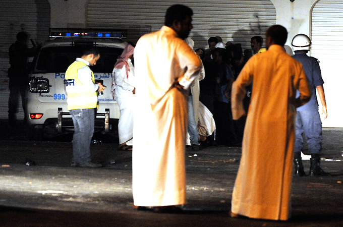 Police preparing to move the body of 16-year-old Bahraini protester who was ...
