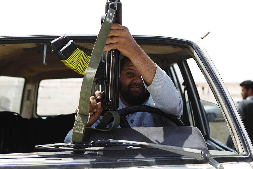 Poorly equipped rebel fighters confronting Gaddafi forces have armed themselves with anything they can find, with an arsenal ranging from meat cleavers to rocket launchers [Reuters]