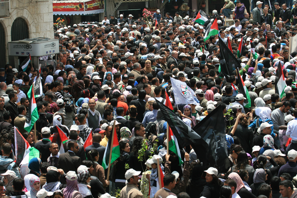 People rally to commemorate the Nakba at al-Manar Square in Ramallah, West Bank [Jon Elmer]