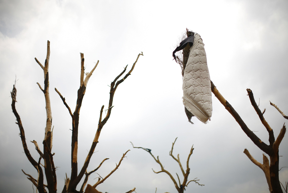 A mattress hangs limp in Joplin, Missouri, in the aftermath of the May 24 tornado. [Reuters]