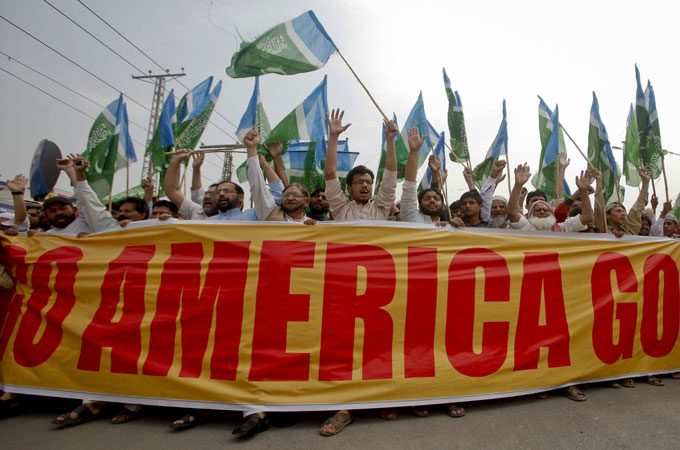 Supporters of the religious political party Jamaat-e-Islami attend an anti-US rally in Lahore, Pakistan [Reuters]