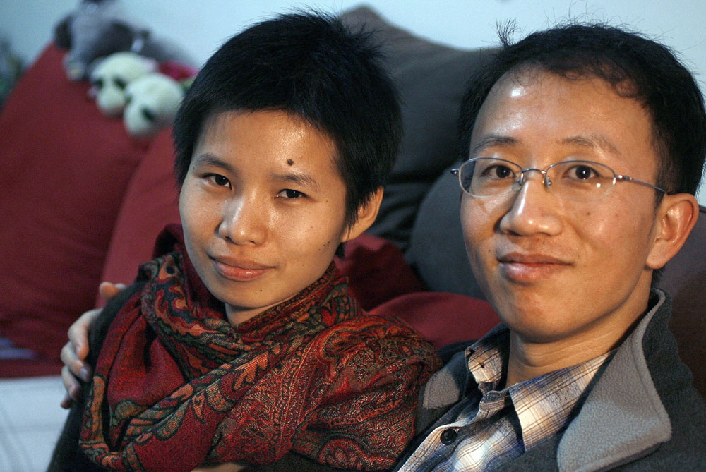 Hu Jia (Released), pictured right, a well-known activist for AIDS patients and orphans, was released by Chinese authorities on June 26, 2011, after more than three years in prison [Getty/Gallo]