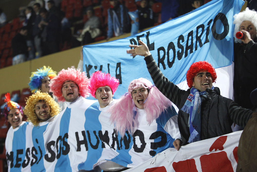 The tournament kicked off in La Plata with hosts Argentina drawing 1-1 against Bolivia. Here supporters wear a big shirt reading (***)Messi, are you human?(***)[EPA]