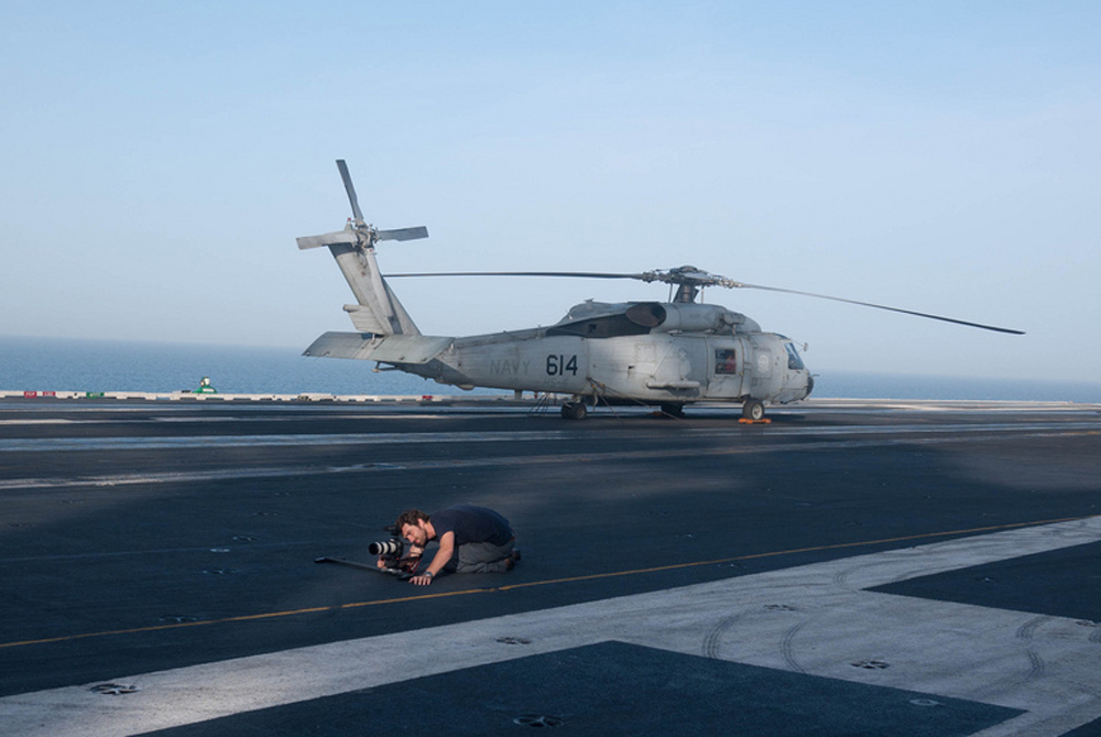 Cameraman Ben Foley Filming on the deck of the USS Ronald Reagan