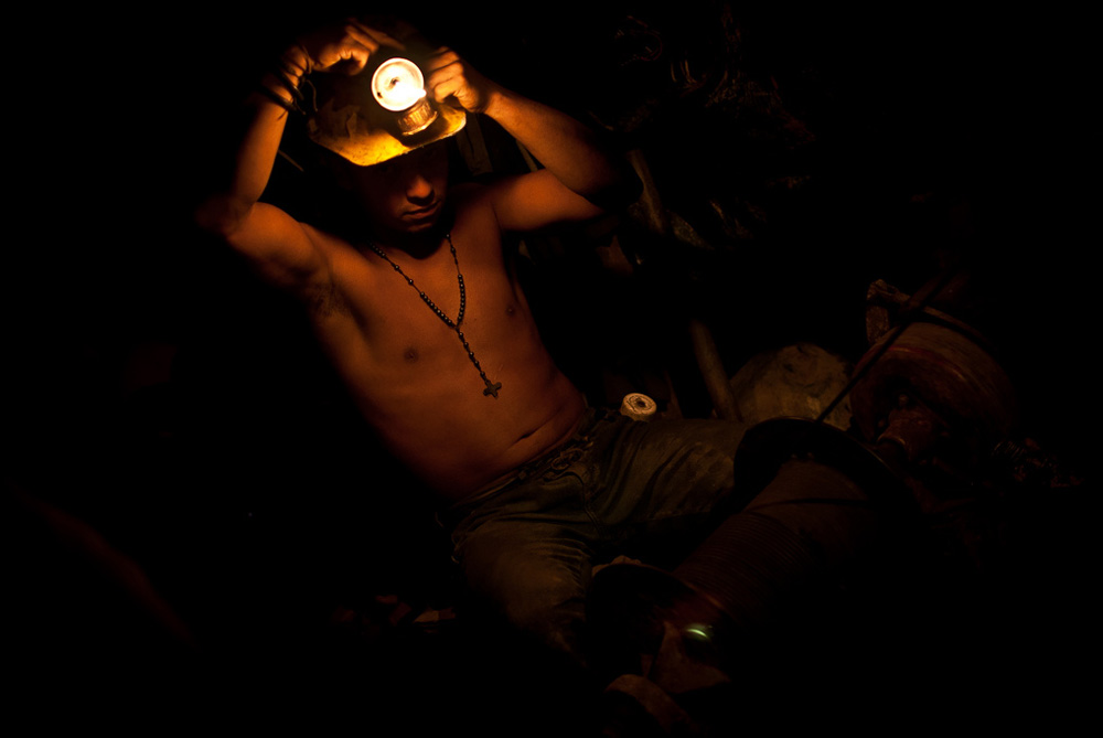 A gold miner more than a kilometre down a 400-year-old shaft at Marmoto, Colombia, a few hours from Medellin [Josh Rushing]