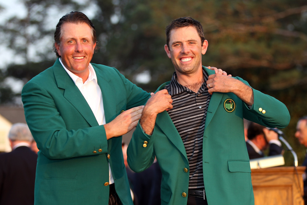 The first major of the year was won by South African Charl Schwartzel. Here he is presented with his Green Jacket by Phil Mickelson. It was Schwartzel(***)s maiden major title as he became the third South African to win the tournament.[GALLO/GETTY]