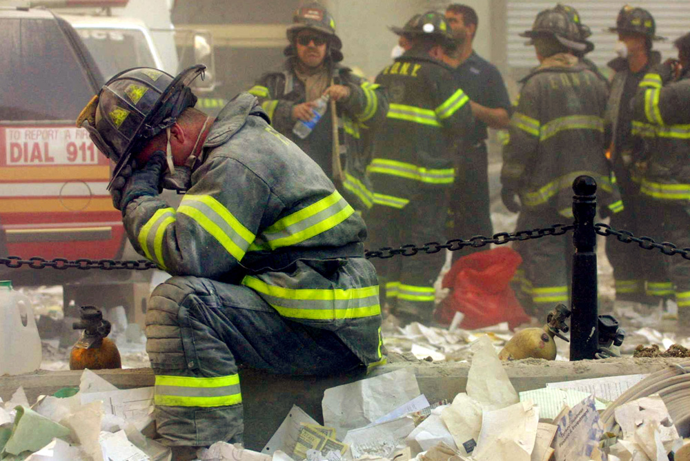 A firefighter breaks down after the World Trade Center buildings collapsed on September 11, 2001, when two hijacked airplanes slammed into the buildings [Mario Tama/GALLO/GETTY]