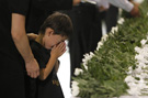 Japan mourns disaster victims six months on