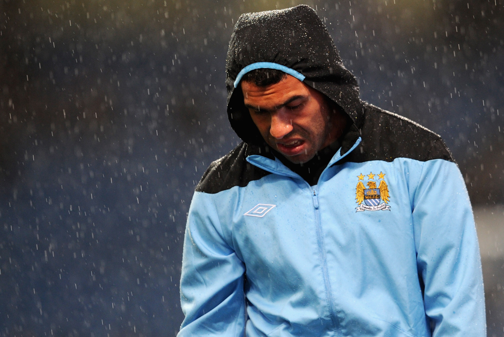 "Out in the cold: Manchester City(***)s Carlos Tevez refuses to play for his club in their 2-0 loss against Bayern Munich. It(***)s the last straw for long-suffering manager Roberto Mancini who said ""If I have my way he will be out. He(***)s finished with me."" [GALLO/GETTY]"
