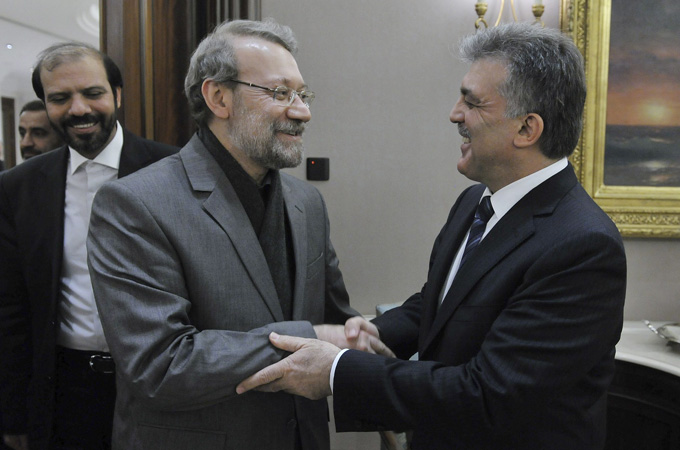 Turkey's president (R) and Iran's parliament speaker reassured support for talks after a meeting in Ankara