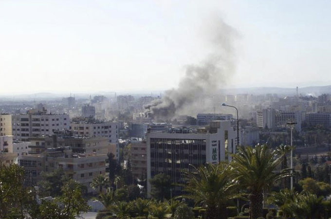 Smoke rises after an explosion in Damascus early on Saturday morning