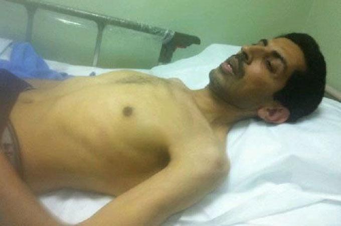 Abdulhadi al-Khawaja in his hospital bed on Saturday.  (Photo Courtesy of Al Jazeera).