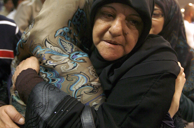 A Lebanese Shia woman arrives at Rafiq Hariri International airport in Beirut on May 22 after being freed