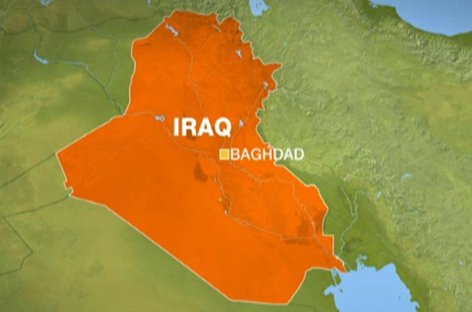 Dozens killed in Iraq cafe blasts
