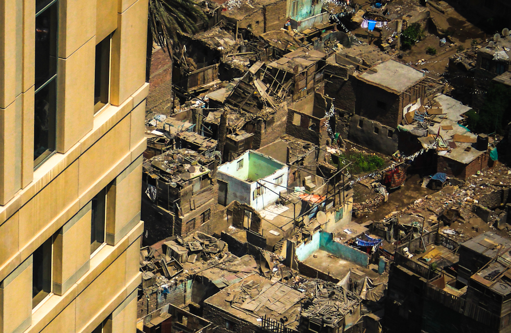 The slums of Ramlet Boulaq, spread out beneath Nile City(***)s gleaming towers, lack almost all modern conveniences, such as plumbing and electricity. [Mosa(***)ab Elshamy/Al Jazeera]